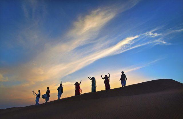 musicians in the desert