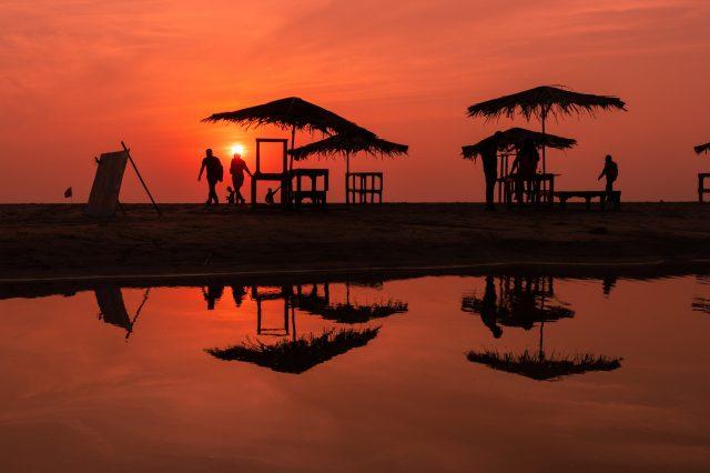 People enjoying sunset at the beach.