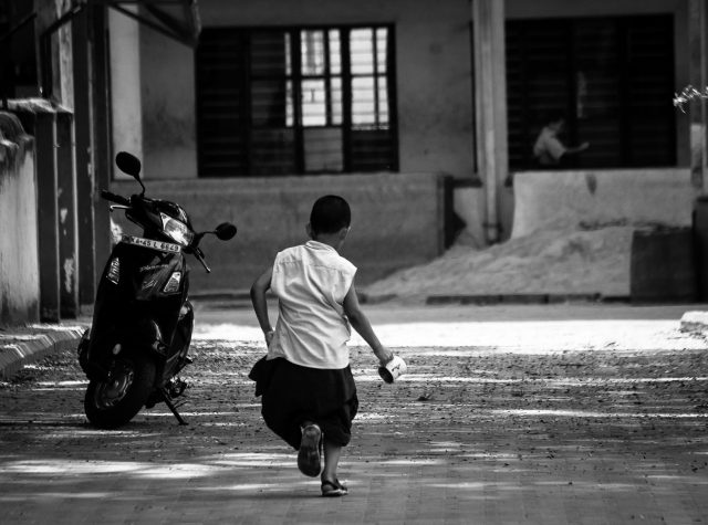 A boy playing in a street