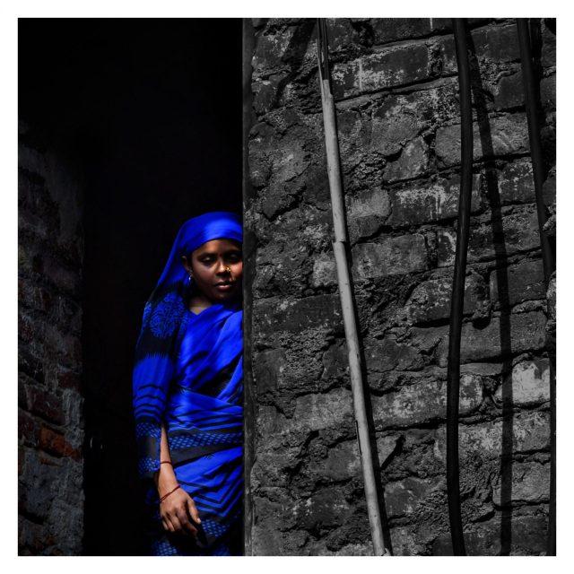 A woman behind a wall