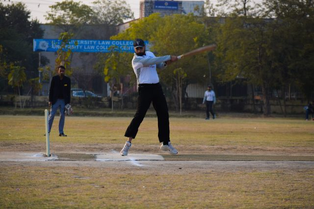 A batsman playing a shot.