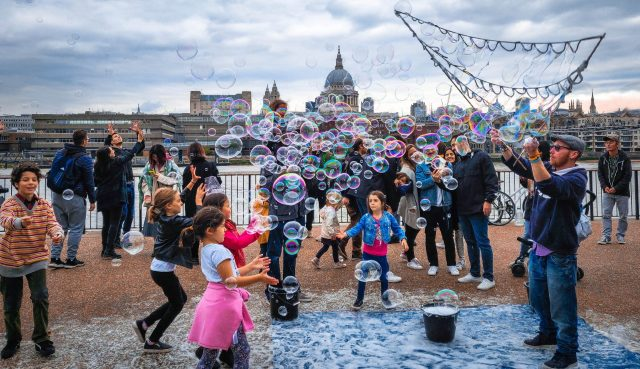 Children playing with bubbles