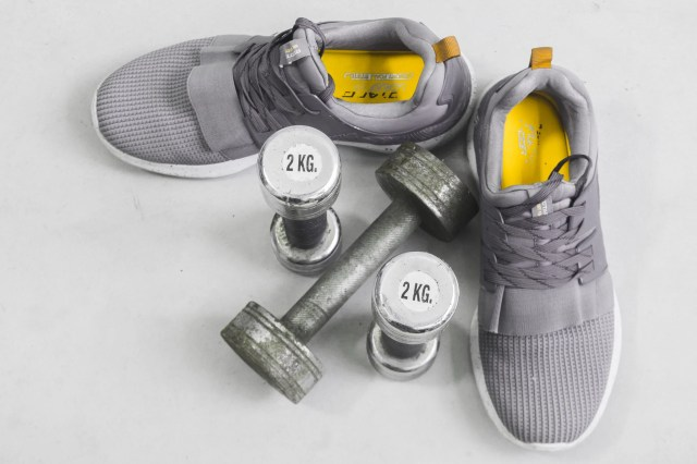 sports shoes and dumbbells