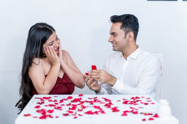 Girl getting happy seeing proposal