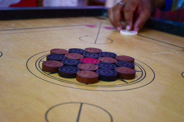 Playing carrom