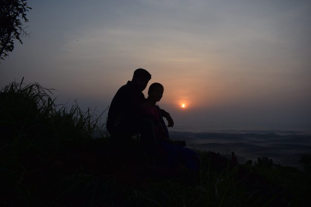 silhouette of a couple on hill top