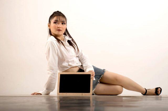 A girl with a slate board