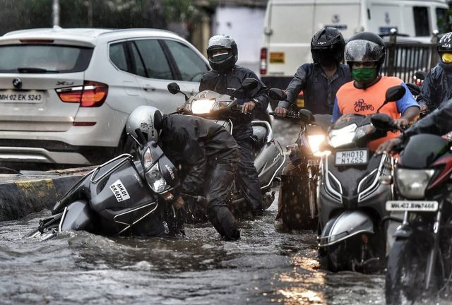 A scooter fall in a flooded road