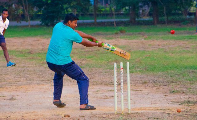 A man playing cricket