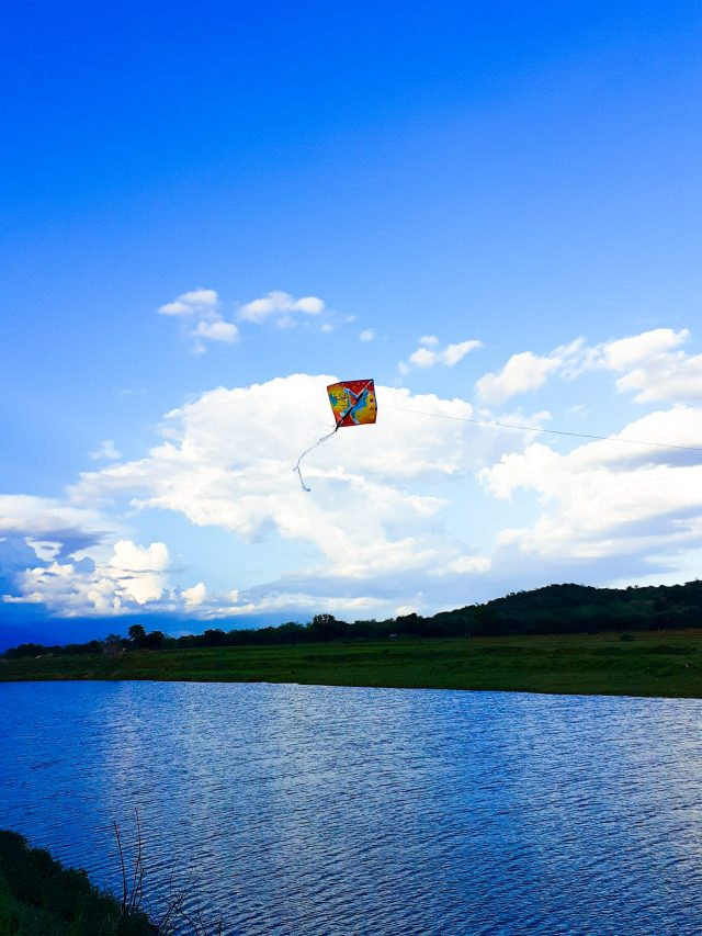 kite flying over a lake