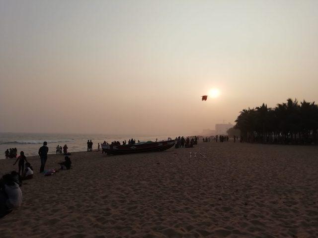 People enjoying sunset at beach
