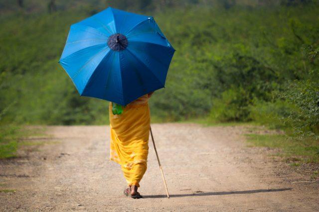 woman walking with umbrella