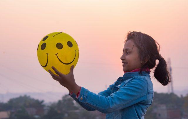 A ball smiley and girl