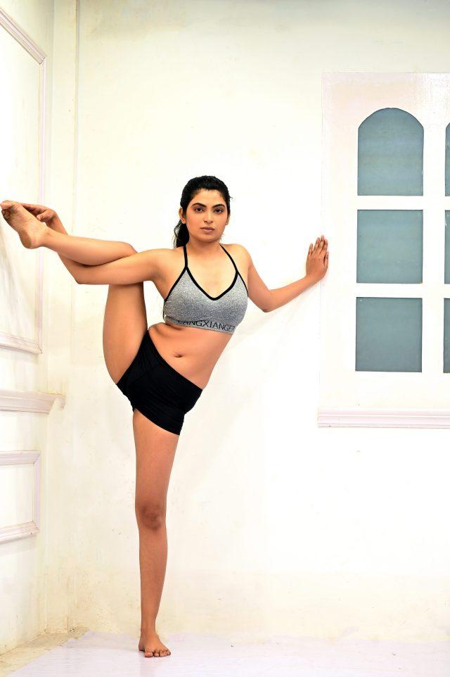 Flexible girl doing yoga exercise