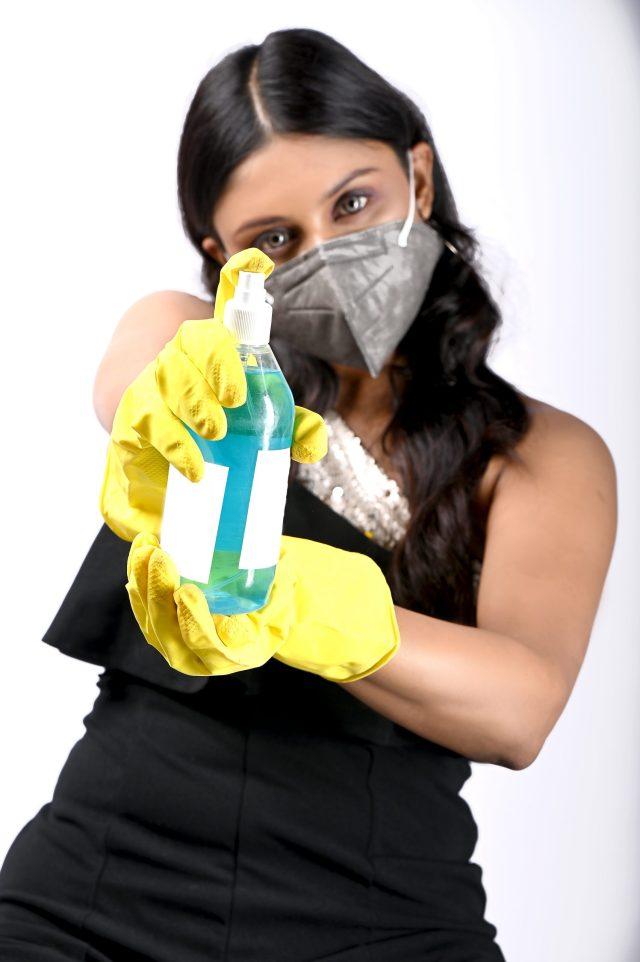 Girl spraying sanitizer