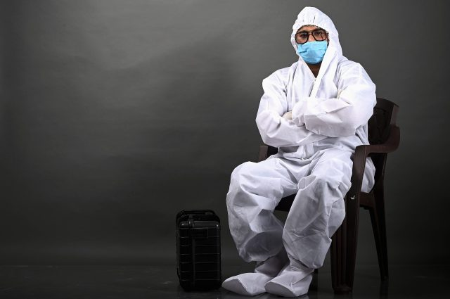 Man in PPE folding his hand