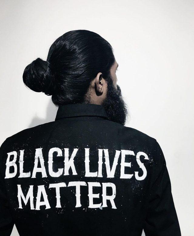 Man wearing shirt with slogan