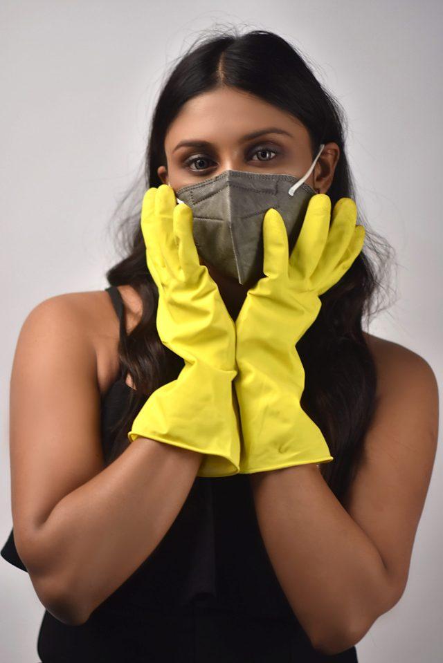 Model posing wearing mask
