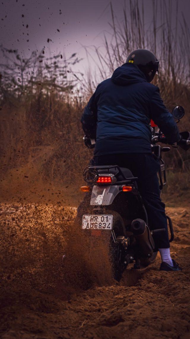 Rider riding bike in mud
