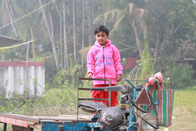 Little girl on autorickshaw
