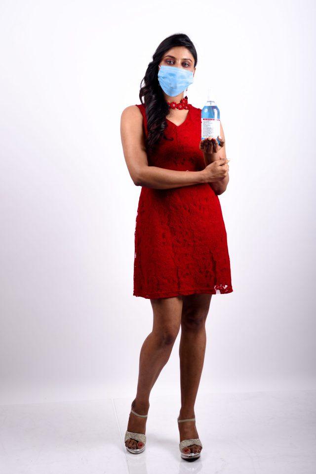 Woman posing hand sanitizer