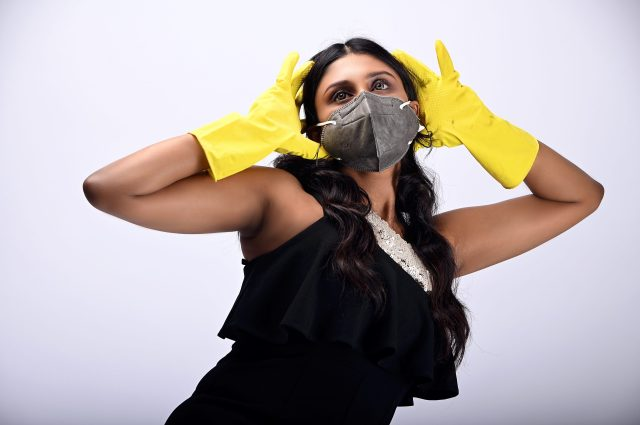 girl wearing mask and gloves