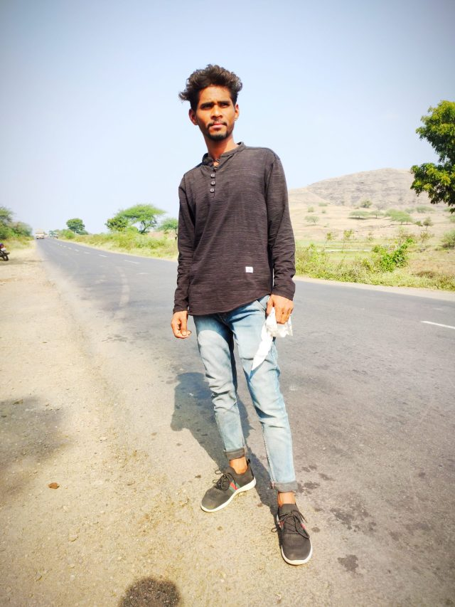 A boy standing on a road