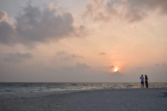 A couple enjoying sunset at a beach