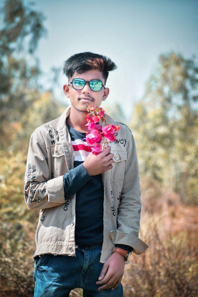 Boy posing with flower in the farm