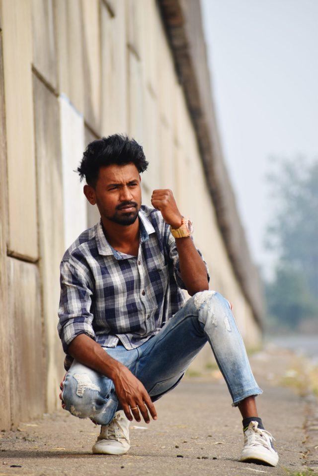 Model boy posing roadside