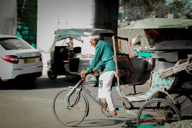 Old Man riding rickshaw