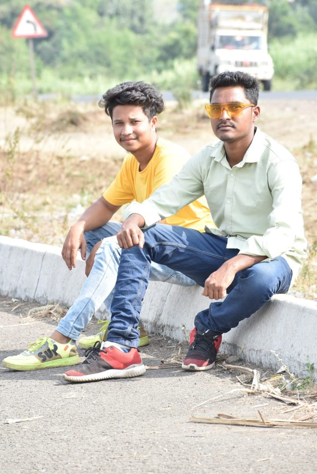 Two boys posing while sitting
