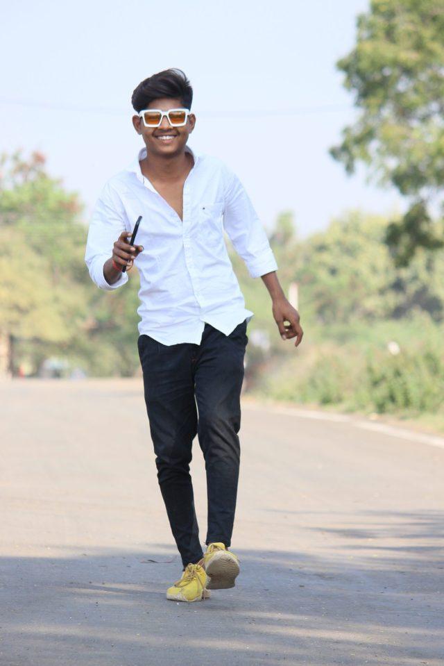 Portrait of a guy walking on a road