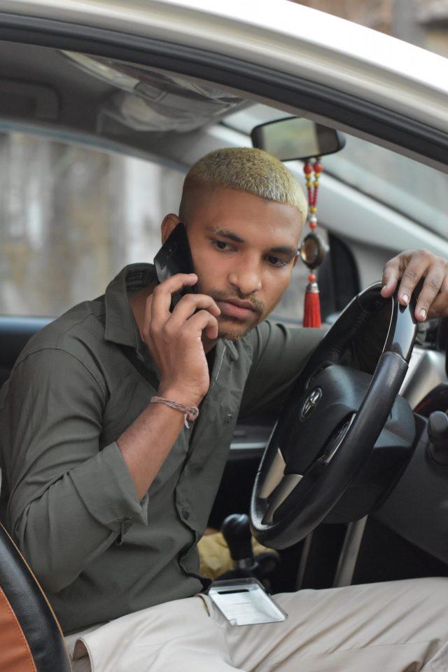 Boy posing in the car