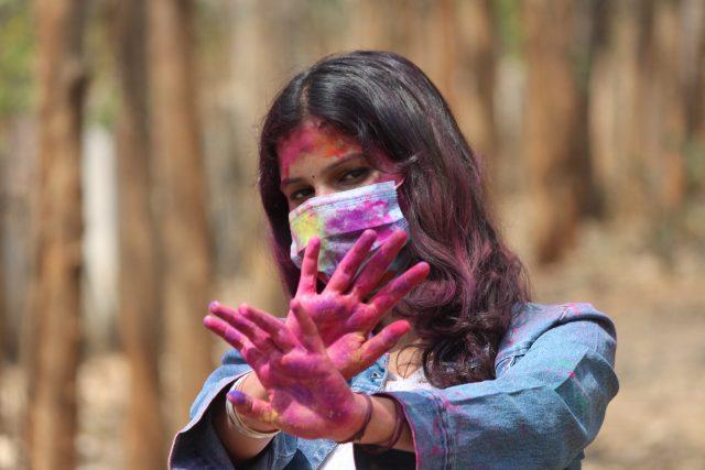 Girl playing Holi