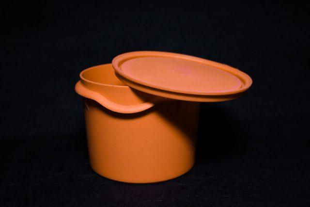 An orange tiffin box