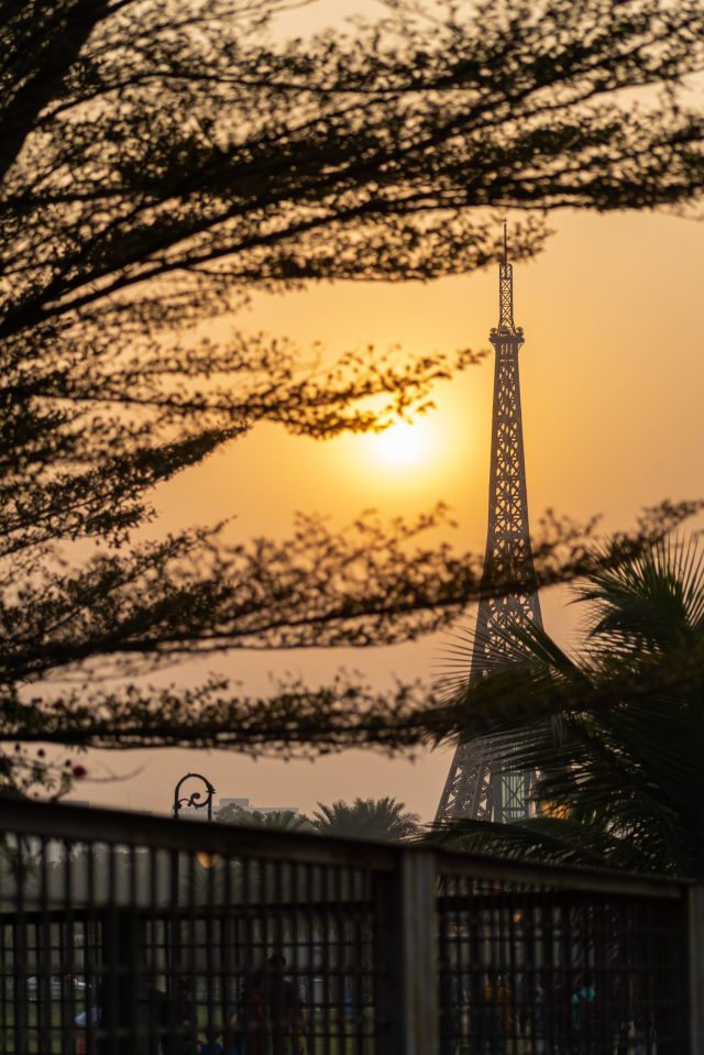 Sunset behind the model of Eiffel Tower