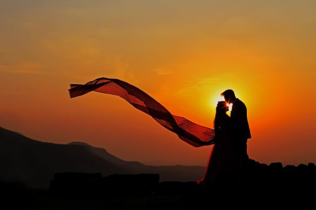 Silhouette of a loving couple in sunset