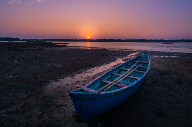 Boat near the river during beautiful sunset
