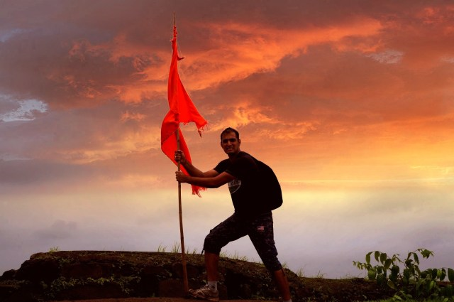 Man posing with flag