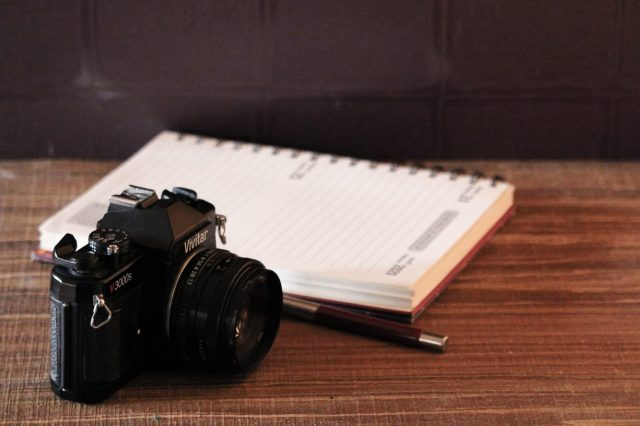 A camera and a notebook
