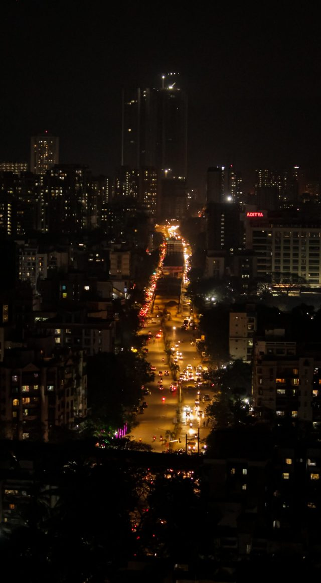 Traffic lights and city building in night