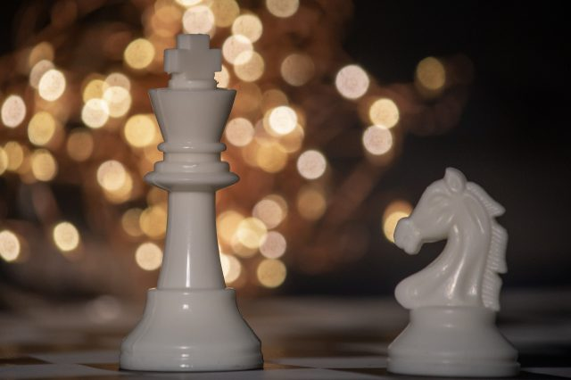 White king and knight chess pieces