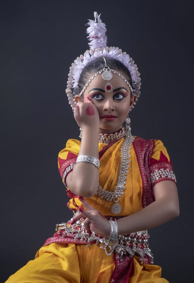 A little girl performing classical dance