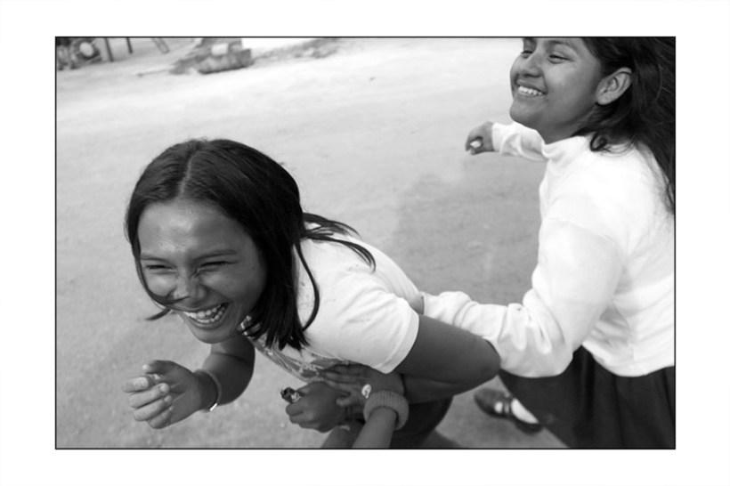 Girls playing around chasing