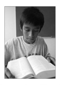 a boy reading the bible