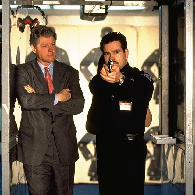 President Bill Clinton with a police officer.