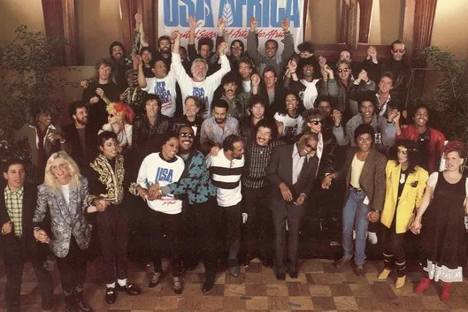Front cover of the 'USA for Africa We are the World' record album, the music on which was designed to raise awareness and funds for a worldwide hunger relief program, 1985. The sleeve features a group photograph of the number of the contributing performers. The records success led the way for the Live Aid concerts later that year. (Photo by Blank Archives/Getty Images)