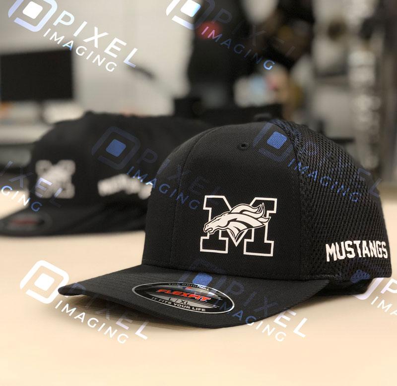 Custom-printed heat-transfer vinyl on baseball caps for a Calgary high school.