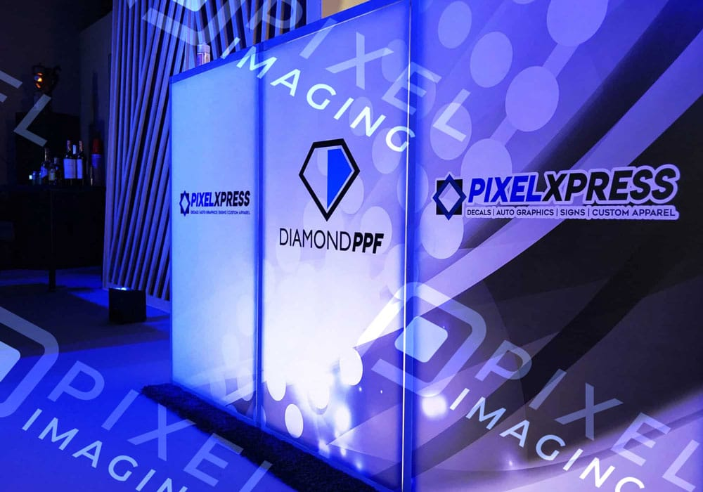 Custom-printed vinyl wrap event décor/decorations on a tradeshow display booth.